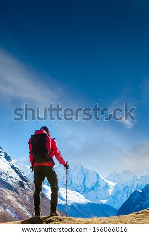 Tourist with a backpack and high in Himalayas  - stock photo