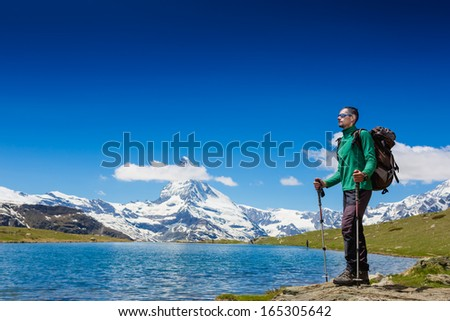 Tourist with a backpack and mountain panorama  - stock photo