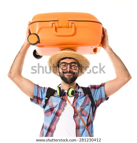 Tourist with baggage on hie head - stock photo