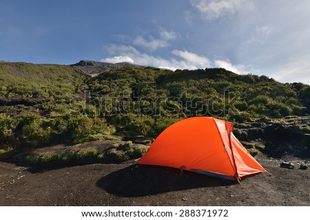 touristic camp at the early morning on Mountain side - stock photo