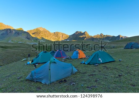 touristic camp in a morning mountains - stock photo
