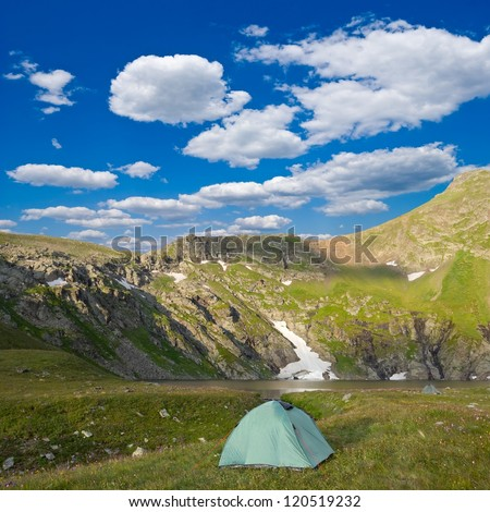 touristic camp in a mountain valley - stock photo