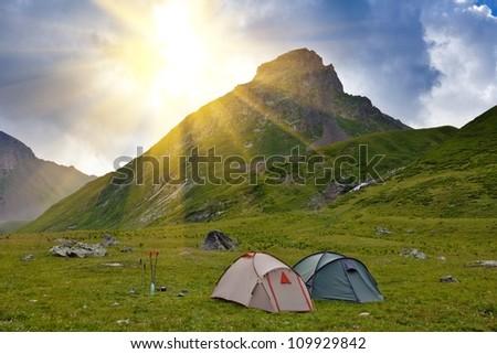 touristic camp near a mountain - stock photo