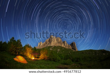 Touristic camp on a background of mountain Big Thach and starry sky. Caucasus, Russia