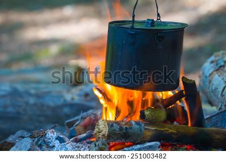 touristic cauldron on a fire - stock photo