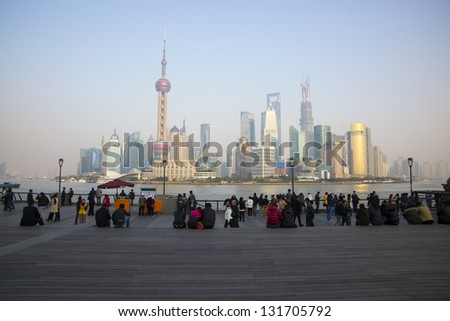 Tourists and the Shanghai skyline - stock photo