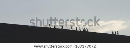 Tourists at Mingsha Shan, Dunhuang, Jiuquan, Gansu Province, China - stock photo
