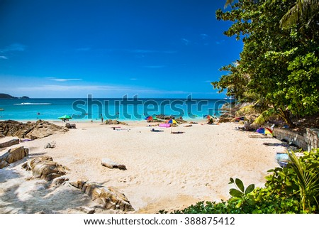 Tourists at Patong beachin Phuket, Thailand. Phuket is a popular destination famous for its beaches. - stock photo