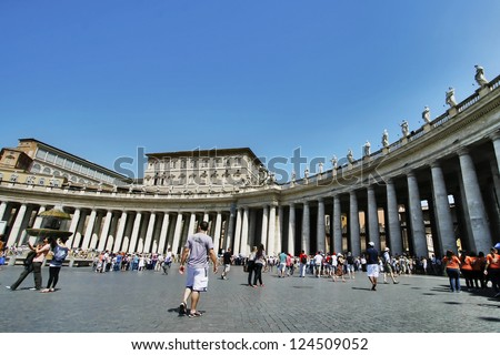 tourists at the plaza in front of Saint Peter Basilica in Vatican - stock photo