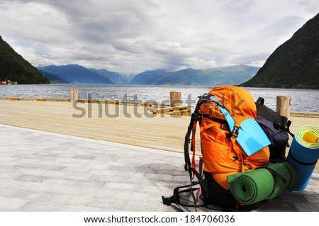 Tourists backpack . Norvegian Fjords on the background - stock photo