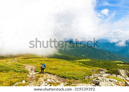 Tourists climb to the top of Hoverla in Carpathians
