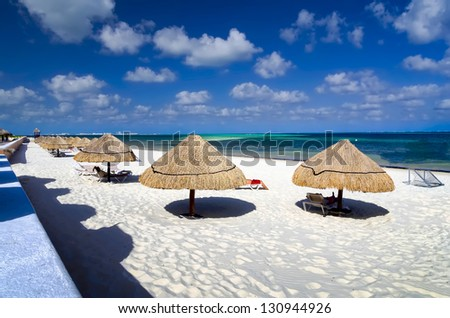 Tourists enjoying the  tropical ocean climate on the beach in Cancun, Mexico - stock photo