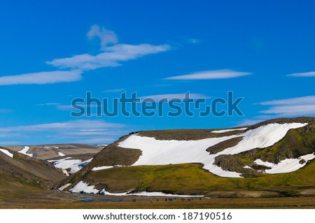 Tourists from a cruise ship hiking on Barentsoya in Svalbard, Norway. - stock photo