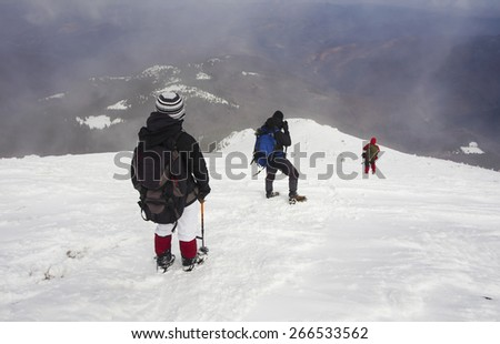 Tourists in a winter mountain
