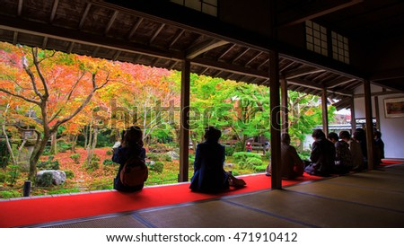 tourists in Enkoji temple enjoy Autumn foliage color at Japanese garden in Kyoto, Japan.