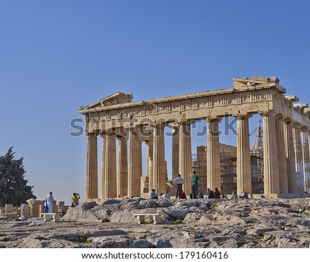 Tourists in front of parthenon temple, Acropolis of Athens, Greece - stock photo