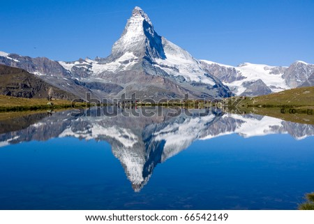 Tourists in front of the Matterhorn - stock photo