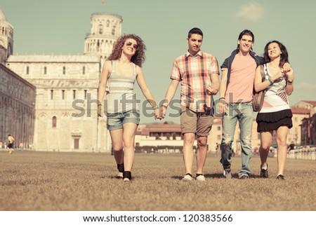 Tourists in Pisa - stock photo