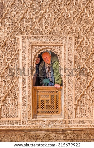 Tourists in the Ben Youssef Madrasa, Marrakesh, Morocco - stock photo