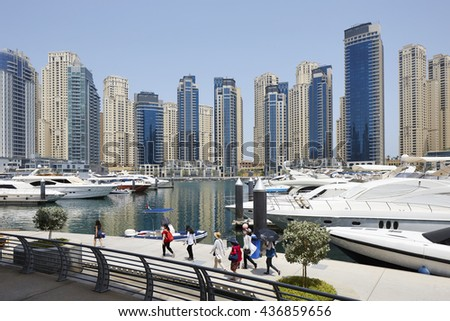 Tourists in the Dubai Marina with The Walk, United Arab Emirates