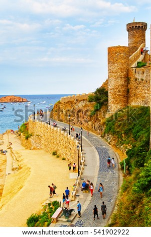 Tourists in the old fort of Tossa de Mar on the Costa Brava at the Mediterranean Sea in Spain.