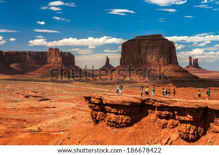 Tourists looks at the beautiful Monument Valley. - stock photo