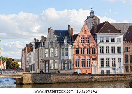 Tourists on the bridge in the ancient city of Belgium-Bruges - stock photo