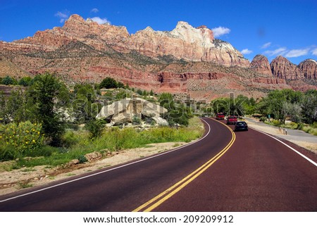 Tourists park outside the park, then take a shuttle into Zion National Park, Utah
