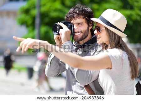 Tourists taking a picture  - stock photo