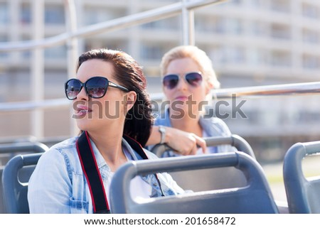 tourists taking an open top bus touring the city - stock photo
