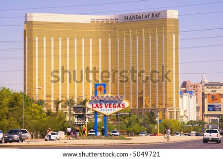 Tourists taking pictures at Las Vegas Sign - stock photo