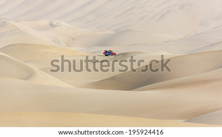 Tourists travel through the dunes in the Atacama Desert - Oasis of Huacachina, Peru, South America - stock photo
