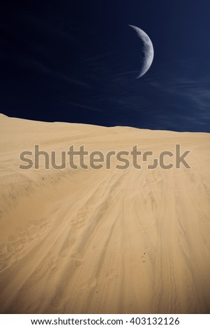Tourists travel through the dunes in the Atacama Desert. Oasis of Huacachina, Peru, South America. moon shines - stock photo