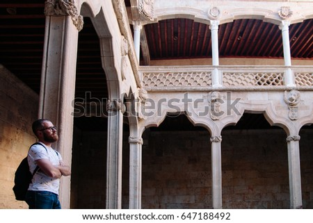 Tourists visiting the historic building and admiring the architecture.