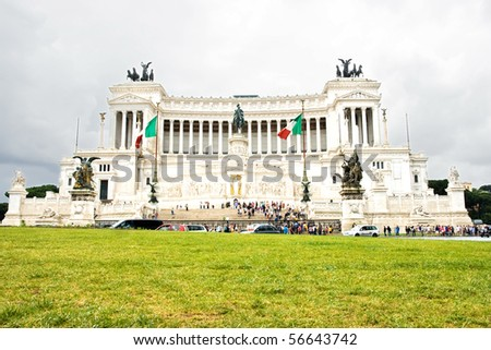 Tourists visiting The Monument of Victor Emmanuel II on a cloudy day in Rome, Italy - stock photo