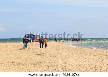 Tourists walking on the beach at Skagen in Denmark - stock photo