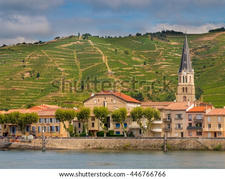 Tournon sur Rhone river town and Vineyards on the Hills of the Cote du Rhone Area in France - stock photo