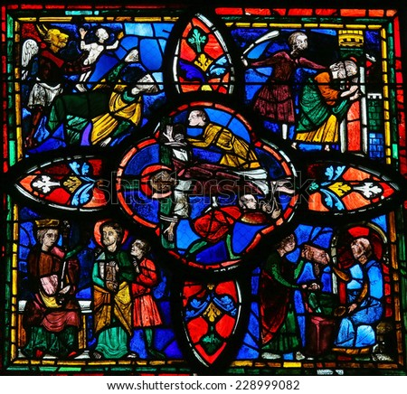 TOURS, FRANCE - AUGUST 14, 2014: Stained glass window dating from the 13th Century in the Cathedral of Tours, France. This window depicts the Crucifixion of Jesus in the center. - stock photo