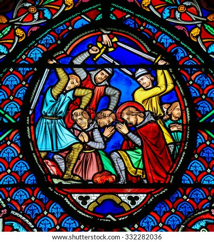 TOURS, FRANCE - AUGUST 14, 2014:  Stained glass window depicting Martyrs in the Saint Gatien Cathedral of Tours, France. - stock photo
