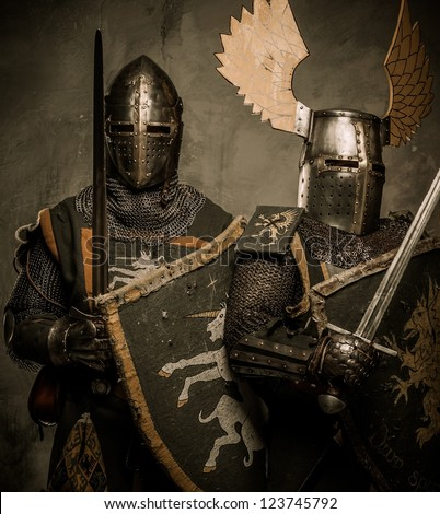 Tow medieval knight in full armour - stock photo