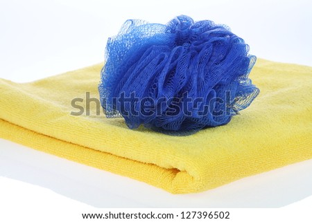 Towel and blue bath puff - stock photo
