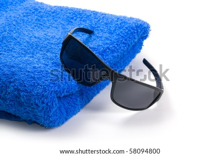 towel and sunglasses on a white background