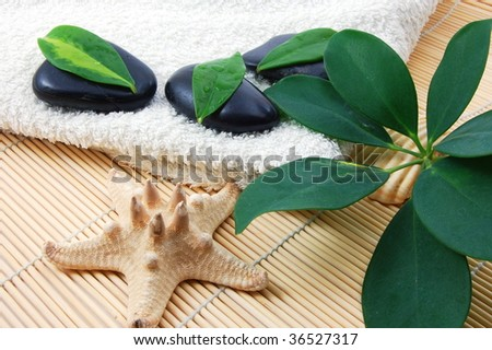towel and zen stones showing a bath or wellness concept