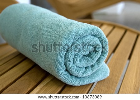 towel braided ore curtailed in a tubule on the wood chair - stock photo