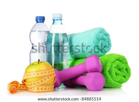 towel, dumbbells, apples and water bottle isolated on white - stock photo