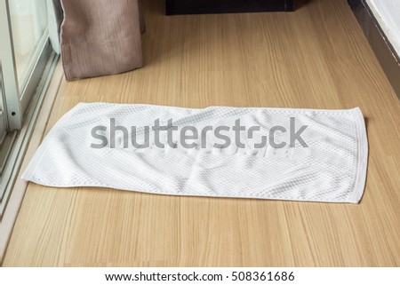 towel fabric doormat on hardwood floor