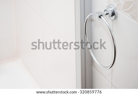 Towel holder in bathroom. Close-up horizontal photo - stock photo