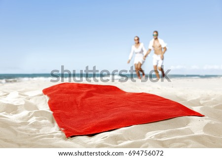 towel on beach and free space