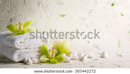 Towel,pebble stones and orchid flower - stock photo