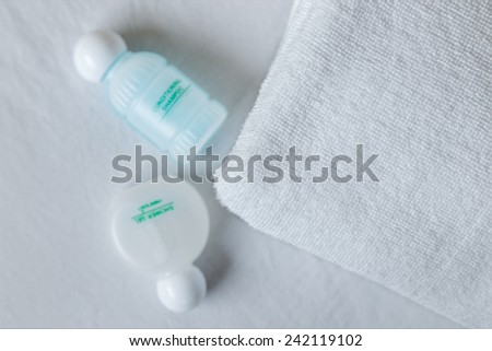 Towel, soap, shampoo - stock photo